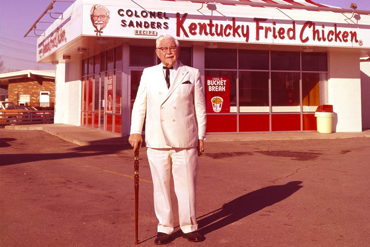 Colonel Sanders inspecting new KFC restaurant